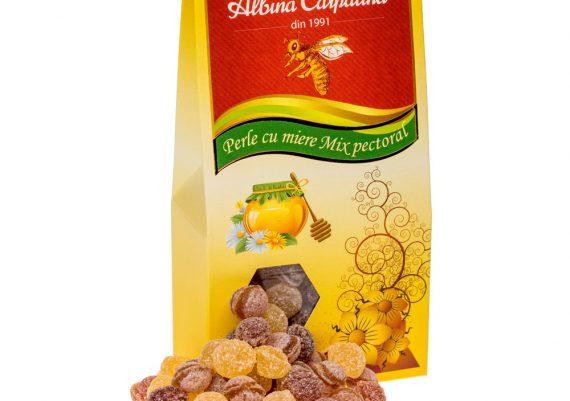 Fotografie cu produse alimentare din miere, bomboane cu miere